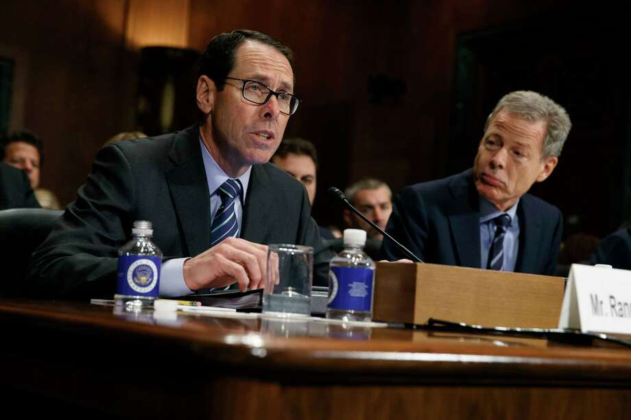 FILE - In this Wednesday, Dec. 7, 2016, file photo, AT&T Chairman and CEO Randall Stephenson, left, testifies on Capitol Hill in Washington, before a Senate Judiciary subcommittee hearing on the proposed merger between AT&T and Time Warner, as Time Warner Chairman and CEO Jeffrey Bewkes listens at right. The Justice Department intends to sue AT&T to stop its $85 billion purchase of Time Warner, according to a person familiar with the matter who was not authorized to discuss the matter ahead of the suit's official filing. (AP Photo/Evan Vucci, File) ORG XMIT: NYBZ163 Photo: Evan Vucci / Copyright 2016 The Associated Press. All rights reserved.