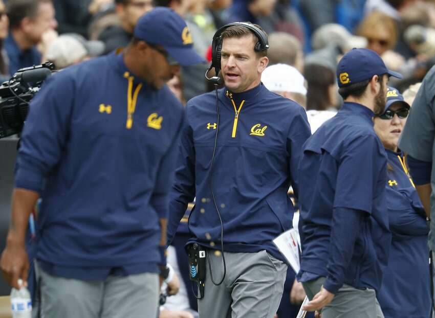 California head coach Justin Wilcox, center, looks on during the first half of an NCAA college football game against Colorado, Saturday, Oct. 28, 2017, in Boulder, Colo. (AP Photo/David Zalubowski)