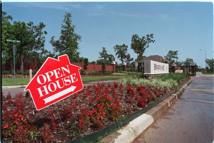 A sign invites would-be homebuyers to an open house in the Canyon Gate subdivision at Cinco Ranch in 2000.