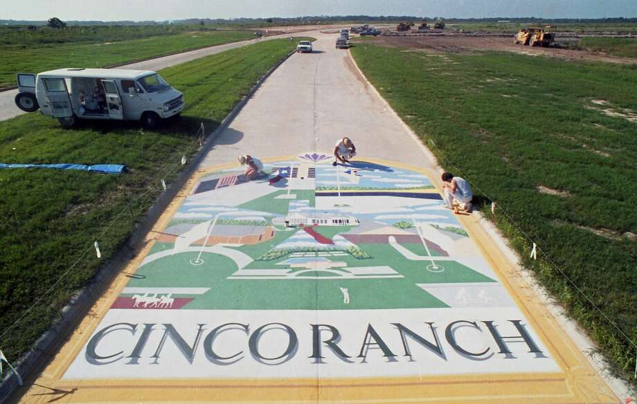 For an opening ceremony in 1986, Mason Road, which bisects Cinco Ranch, was decorated with a street mural depicting past and future uses of the historic property. Photo: Carlos Antonio Rios/Houston Chronicle