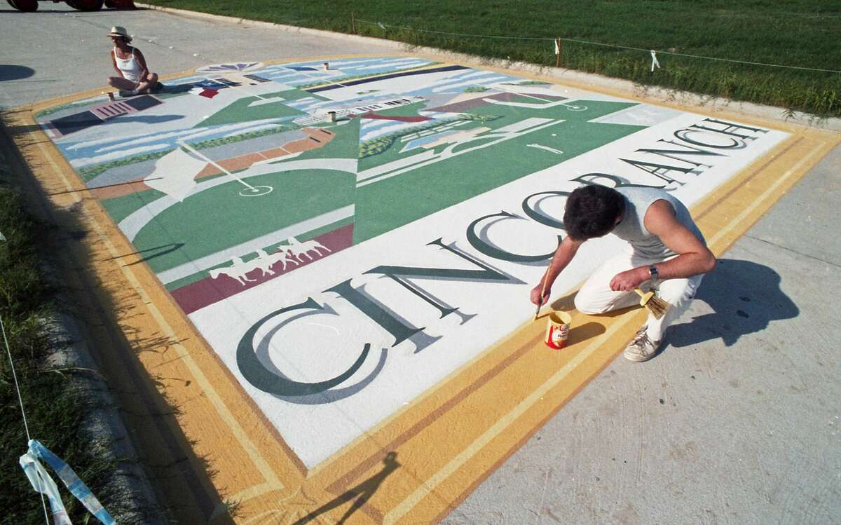 For an opening ceremony in 1986, Mason Road, which bisects Cinco Ranch, was decorated with a street mural depicting past and future uses of the historic property.
