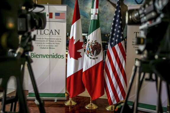 Canadian, Mexican, and American flags stand on display during the fifth round of North American Free Trade Agreement (NAFTA) negotiations in Mexico City, Mexico, on Tuesday, Nov. 21, 2017. Mexico is proposing to limit access to government contracts for U.S. firms in a sign that America's Nafta partners are willing to strike back against what they see as hardline proposals by the Trump administration. Photographer: Alejandro Cegarra/Bloomberg