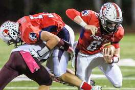Foran's Jared Hubler runs against Sheehan on Oct. 20