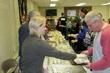 The 28th annual Thanksgiving Blessing Dinner took place at St. Hubert Parish's Oswald Hall in Bad Axe. Around 250 people attended the gathering, which is sponsored by the parish along with the Community Cooks. (Seth Stapleton/Huron Daily Tribune)