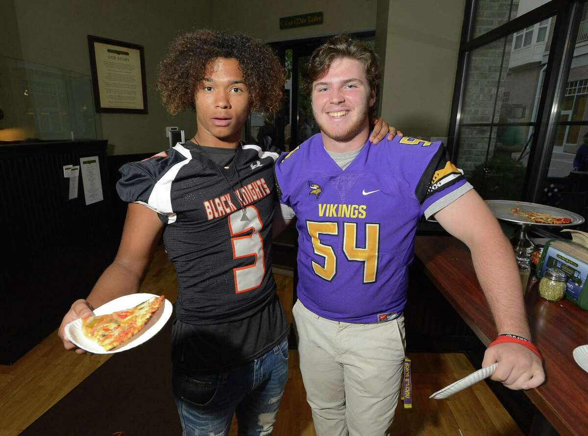 Although they will meet as rivals on the playing field, Stamford Matthew Doyle and Westhill Jack Williamson put their rivalry aside during the FCIAC Football Media Day at the Colony Grill in Norwalk, Connecticut on Wednesday, August 30, 2017.