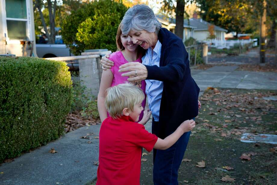 Donna Hickman embraces her grandchildren, Alex, 6, and Victoria, 12, as they move into their new home in Calistoga. Alex and Victoria, along with their parents, were burned out of their rental home by the Tubbs Fire. The Chronicle's Season of Sharing helped them rent a new place in Calistoga. Photo: Santiago Mejia, The Chronicle