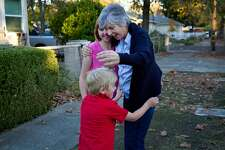 Donna Hickman embraces her grandchildren, Alex, 6, and Victoria, 12, as they move into their new home on Friday, Nov. 17, 2017, in Calistoga, Calif. Alex and Victoria, along with their parents, were burned out of their rental home by the Tubbs Fire. The Chronicle's Season of Sharing helped them rent a new place in Calistoga.