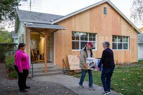 Michelle Hickman takes a breather as in-laws Jim and Donna Hickman help with the move to a new home.
