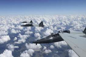 Two T-38C Talon jets from the 435th Fighter Training Squadron return to base after a training mission in this 2016 photo. The Air Force said Tuesday it had suspended flight operations at Laughlin AFB in Del Rio a day after a T-38 jet crashed, killing one pilot and leaving another injured.