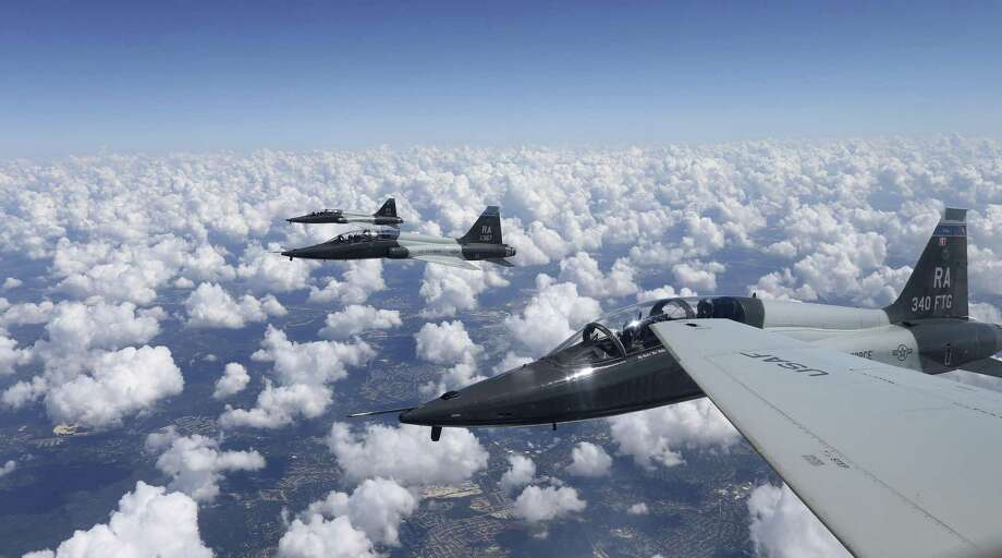 Two T-38C Talon jets from the 435th Fighter Training Squadron return to base after a training mission in this 2016 photo. The Air Force said Tuesday it had suspended flight operations at Laughlin AFB in Del Rio a day after a T-38 jet crashed, killing one pilot and leaving another injured. Photo: Edward A. Ornelas /San Antonio Express-News / © 2016 San Antonio Express-News