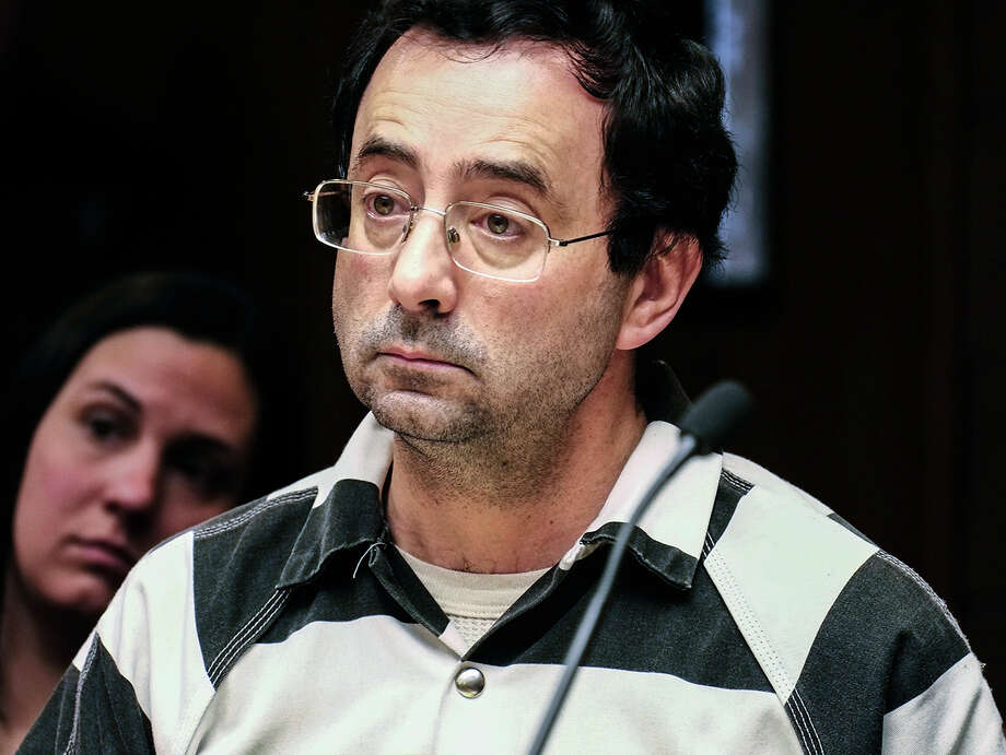FILE - In this Feb. 17, 2017, file photo, Dr. Larry Nassar listens to testimony of a witness during a preliminary hearing, in Lansing, Mich. Nasser, the former Michigan State University and USA Gymnastics doctor accused of molesting girls at his home and a campus clinic is expected to change his not-guilty plea. Online court records show a change-of-plea hearing for Nassar is set for Nov. 22 a week before jury selection was to begin. (Robert Killips  /Lansing State Journal via AP, File) ORG XMIT: MILAN501 Photo: Robert Killips / Lansing State Journal