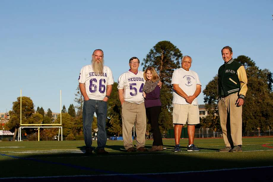 Don Simoni, Ray Balzarini,  Laurie Balzarini, Frank Enriquez and Bo Crane stand for a portrait at Sequoia High School in Redwood City.  Simoni, Balzarini and Enriquez  played on the Sequoia High School football team that won the Little Big Game, between Sequoia and Palo Alto,  to go undefeated in 1967. Photo: Lea Suzuki, The Chronicle