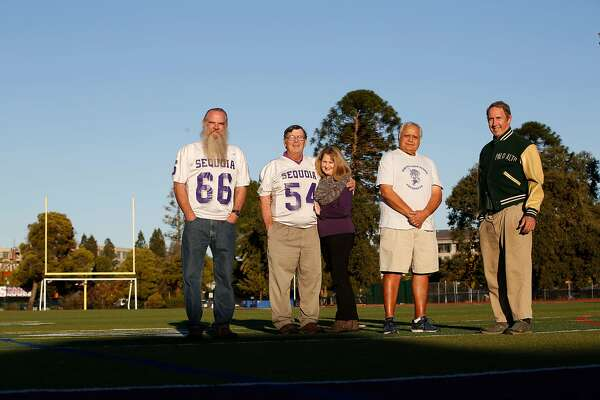 Don Simoni , Ray Balzarini,  Laurie Balzarini,  who was Laurie Ryan and a pom pom girl  at Sequoia High School back in 1967, Frank Enriquez and Bo Crane stand for a portrait at Sequoia High School on Tuesday, November 14,  2017 in Redwood City, Calif.  Simoni,Balzarini and Enriquez  played on the Sequoia High School football team that won the Little Big Game, between Sequoia and Palo Alto,  to go undefeated in 1967. Crane played for Palo Alto the same year.