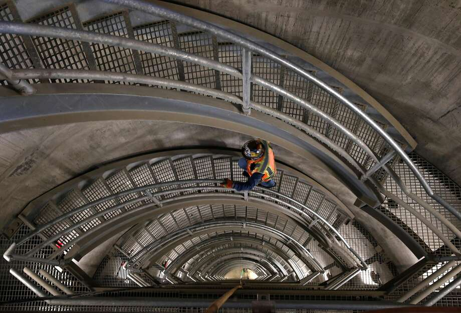 Field operations manager John Rocca climbs a staircase inside the new intake tower of the Calaveras Dam replacement project. Photo: Paul Chinn, The Chronicle