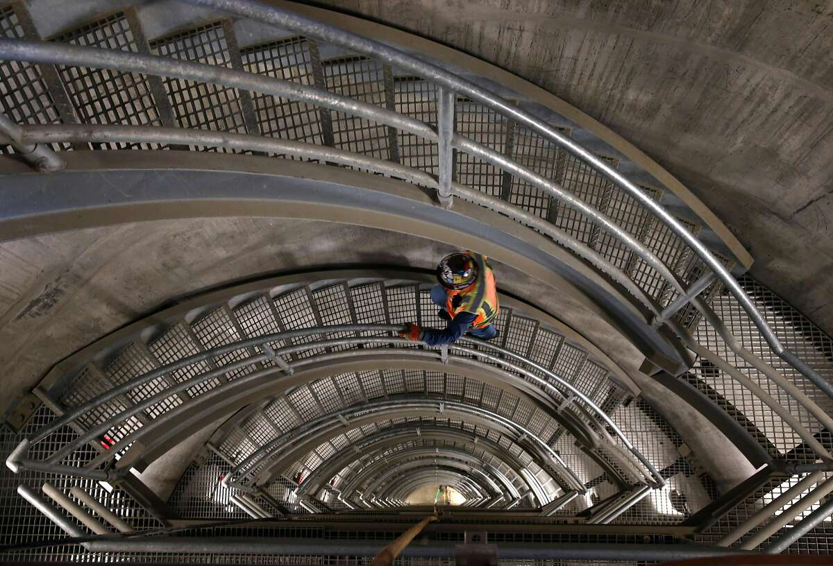 Field operations manager John Rocca climbs a staircase inside the new intake tower of the Calaveras Dam replacement project near Sunol, Calif. on Tuesday, Nov. 14, 2017. The SFPUC is replacing the original seismically unreliable dam, which was completed in 1925, with a 220-foot high rock and earthen dam.