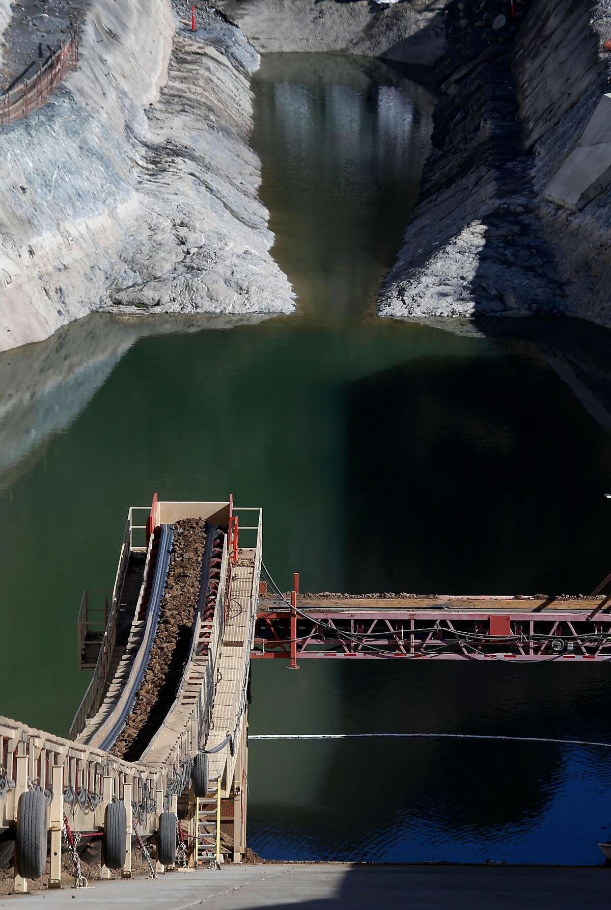 An elaborate conveyor system transports dirt and other material 3,000 feet to the base of the Calaveras Dam replacement project near Sunol, Calif. on Tuesday, Nov. 14, 2017. The SFPUC is replacing the original seismically unreliable dam, which was completed in 1925, with a 220-foot high rock and earthen dam.