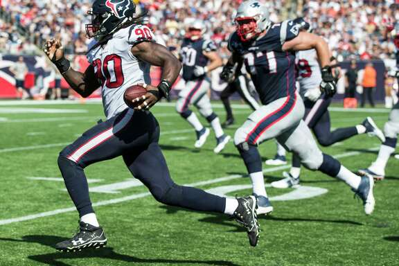The Texans' Jadeveon Clowney (90) found his way into the end zone against the Patriots with a fumble return.