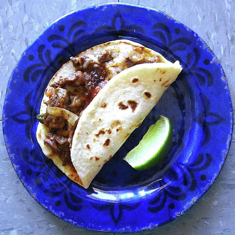 Fajita ranchera taco on a handmade flour tortilla from Reyna's Taquería. Photo: Mike Sutter /San Antonio Express-News