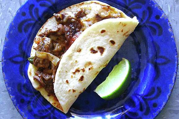 Fajita ranchera taco on a handmade flour tortilla from Reyna's Taquería.