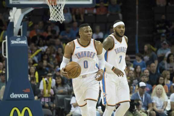 "OKLAHOMA CITY, OK - OCTOBER 8: Russell Westbrook #0 of the Oklahoma City Thunder and Carmelo Anthony #7 of the Oklahoma City Thunder against Melbourne United during the first half of a NBA preseason game at the Chesapeake Energy Arena on   October 8, 2017 in Oklahoma City, Oklahoma. NOTE TO USER: User expressly acknowledges and agrees that, by downloading and or using this photograph, User is consenting to the terms and conditions of the Getty Images License Agreement. (Photo by J Pat Carter/Getty Images) *** Local Caption ***Russell Westbrook; Carmelo Anthony""n""n""n""n""n"