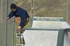 Sam Speck, of Kent, skateboards in the New Milford Skateboard Park on Tuesday afternoon  .