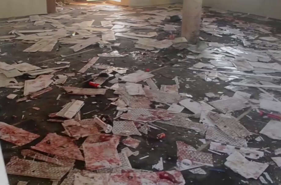 This image taken from TV, shows the interior of a mosque after a deadly attack by a suicide bomber, in Mubi, Adamawa State, Nigeria, Tuesday Nov. 21, 2017.  A teenage suicide bomber detonated as worshippers gathered for morning prayers at a mosque in northeastern Nigeria, killing at least 50 people, police said Tuesday, in one of the region's deadliest attacks in years. (AP Photo) Photo: TEL / AP