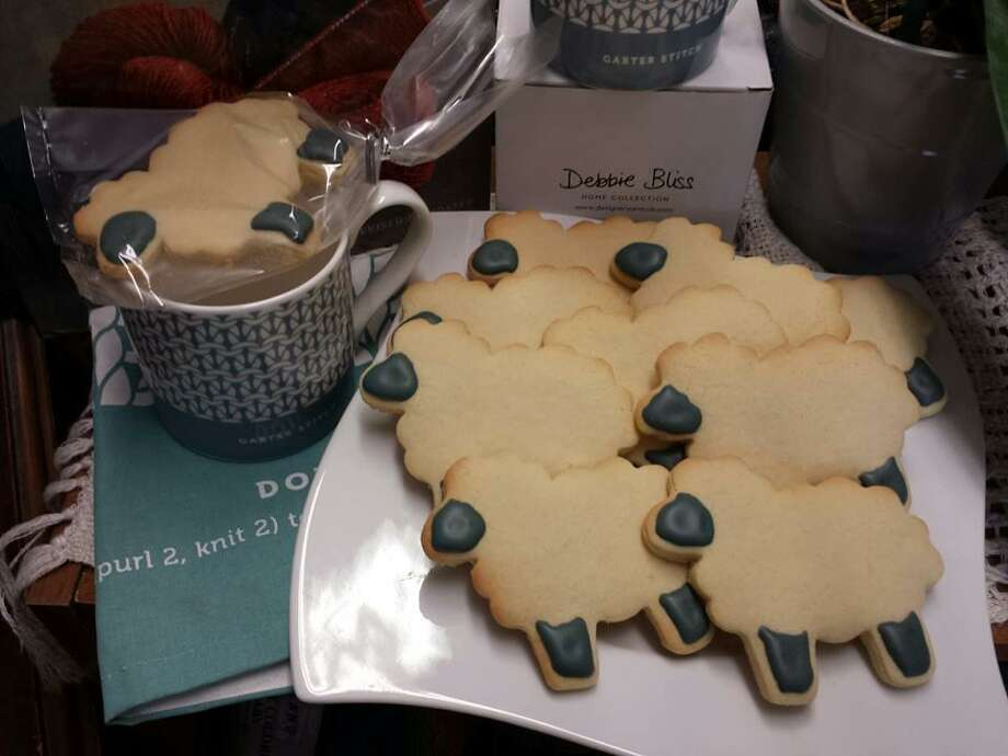 Of course, Small Business Saturday would not be complete without In Sheeps Clothing's signature sheepy sugar cookies made by local First Act Bakery. Photo: Photo By Ginger Balch /Not For Resale