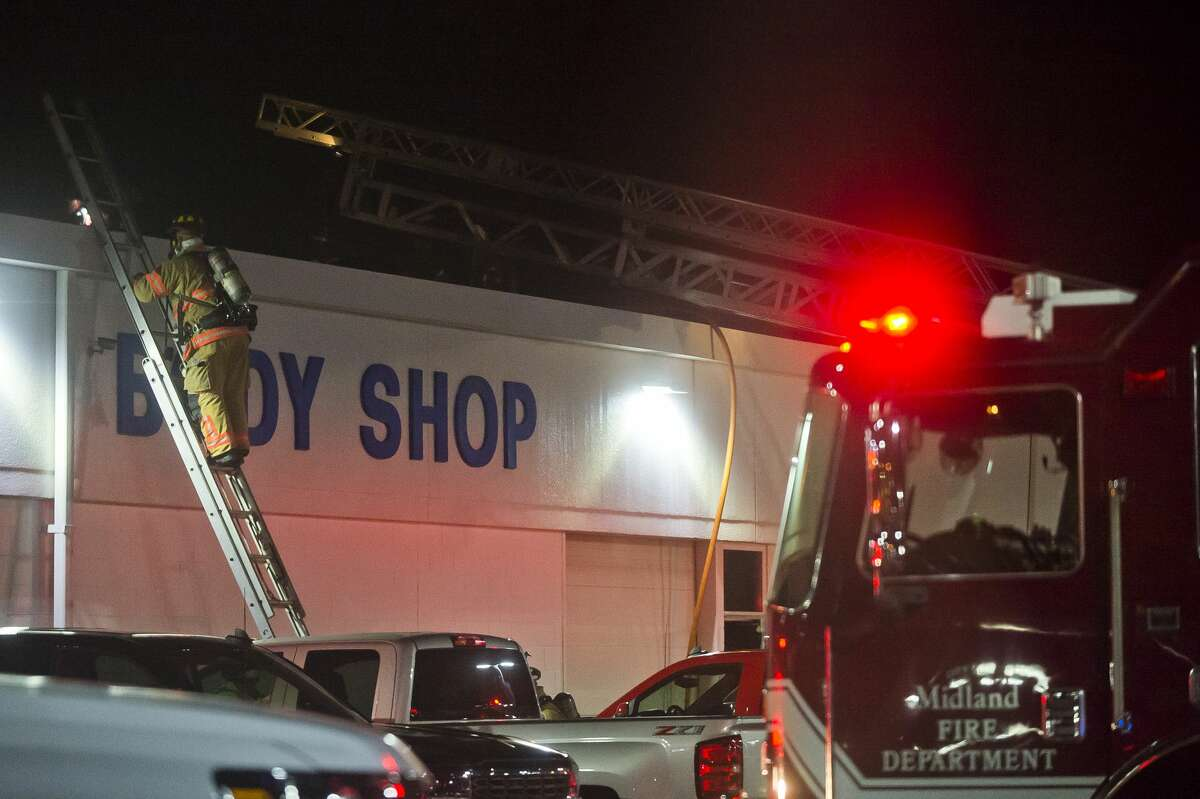 Members of the Midland Fire Department work to put out a fire at Garber Chevrolet at 1700 N. Saginaw Road on Tuesday, Nov. 21, 2017. (Katy Kildee/kkildee@mdn.net)