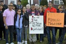 From left, Raphael Benavides and his daughters, Allison, 10, and Brianna, 12, stand with supporters of Miriam Martinez Lemus during a prayer vigil outside the family's home in Stamford on Tuesday.