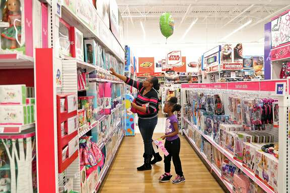 Shakondi Lee and her daughter Makenzie Lee-Foster shop at Toys R Us in Concord, Calif., on Tuesday, November 21, 2017.