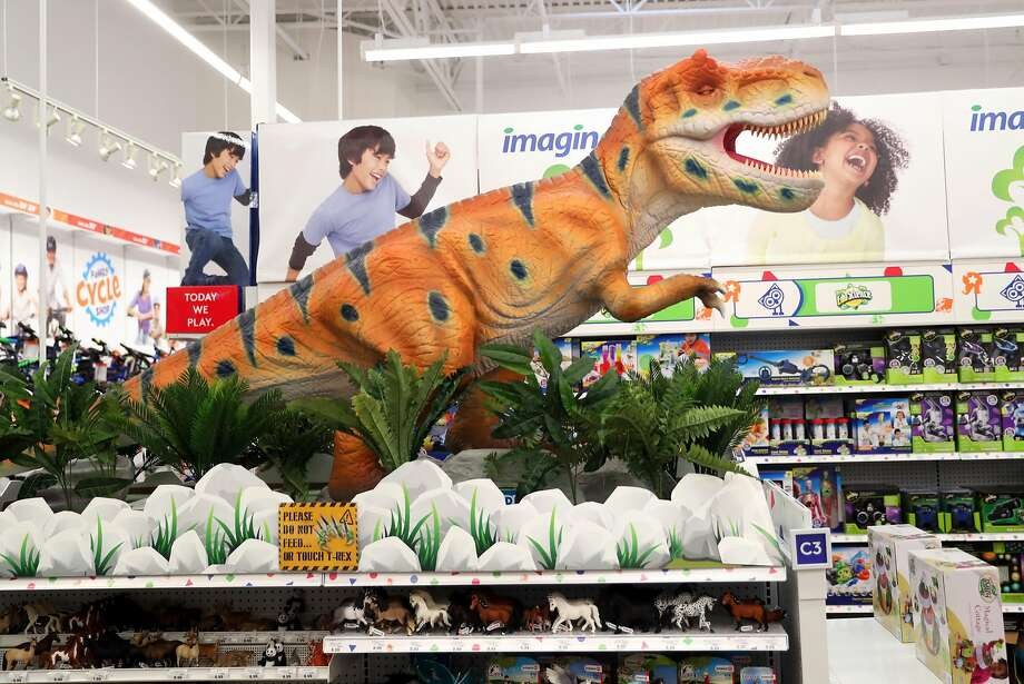 The Concord Toys R Us store features an animatronic T. rex welcoming holiday shoppers. Photo: Scott Strazzante, The Chronicle