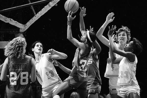 San Francisco Pioneers play the Milwaukee Does According to the back of the photo ..  #13 Pat Mayo, #45 Brenda Martin, # 33 Muisette McKinney, all Pioneers, November 29, 1979    Photo ran 11/30/1979, p. 79