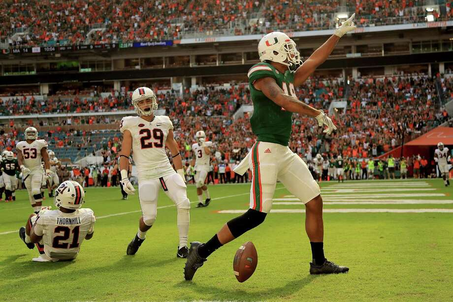 MIAMI GARDENS, FL - NOVEMBER 18:  Lawrence Cager #18 of the Miami Hurricanes celebrtaes a touchdown during a game against the Virginia Cavaliers at Hard Rock Stadium on November 18, 2017 in Miami Gardens, Florida.  (Photo by Mike Ehrmann/Getty Images) ORG XMIT: 775053190 Photo: Mike Ehrmann / 2017 Getty Images