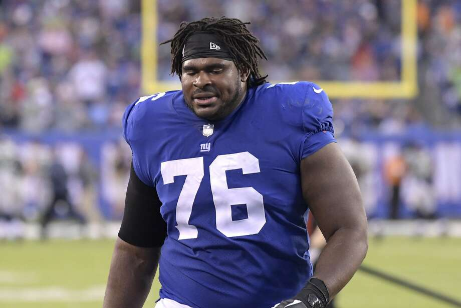 New York Giants offensive guard D.J. Fluker (76) heads to the locker room after the first half of an NFL football game against the Seattle Seahawks, Sunday, Oct. 22, 2017, in East Rutherford, N.J. (AP Photo/Bill Kostroun) Photo: Bill Kostroun, Associated Press