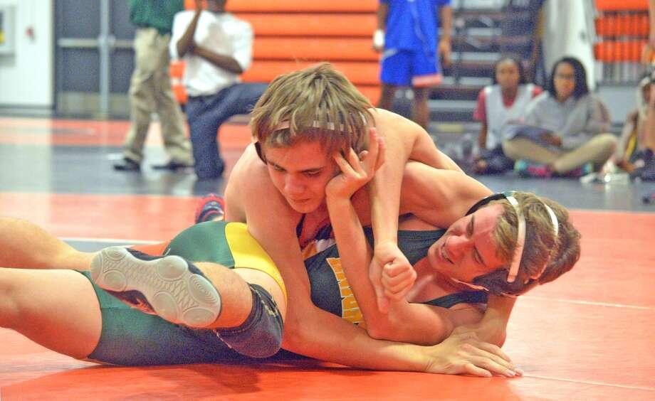 Edwardsville freshman Grant Schmidt, top, wrestles Metro-East Lutheran freshman Jakob Schroeder in a 113-pound match on Tuesday at Jon Davis Wrestling Center.