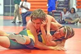 Edwardsville freshman Grant Schmidt, top, wrestles Metro-East Lutheran freshman Jakob Schroeder in a 113-pound match on Tuesday at Jon Davis Wrestling Center.