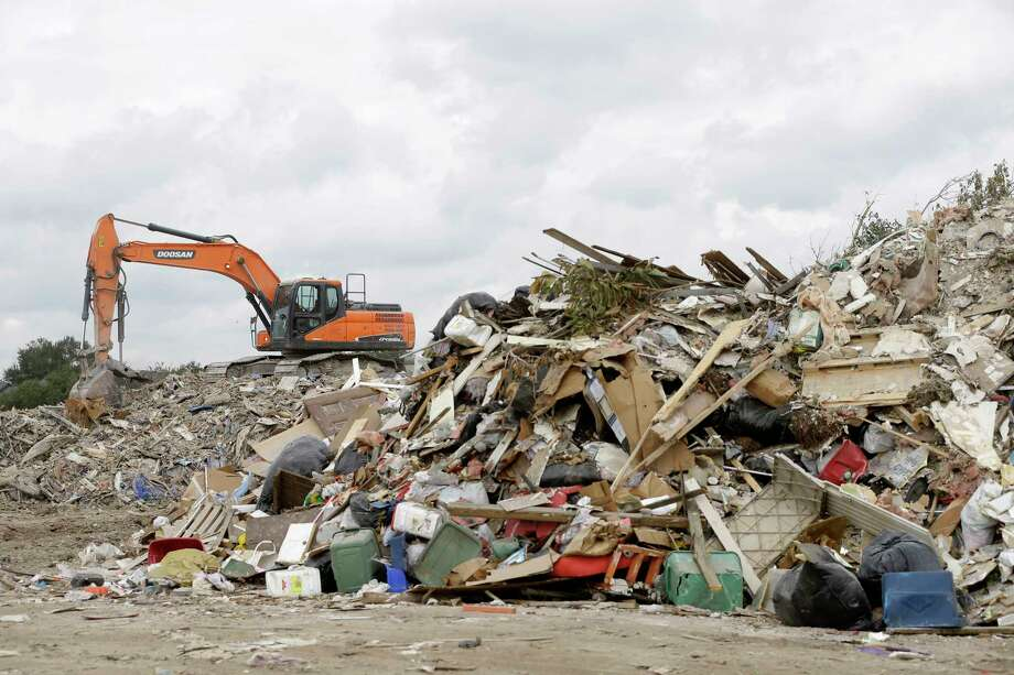 A debris site in the Bear Creek area last week. Crews picked up 26,094 truckloads as of Nov. 13, with 40 percent of it from the Addicks Reservoir area alone. Photo: Melissa Phillip, Houston Chronicle / © 2017 Houston Chronicle