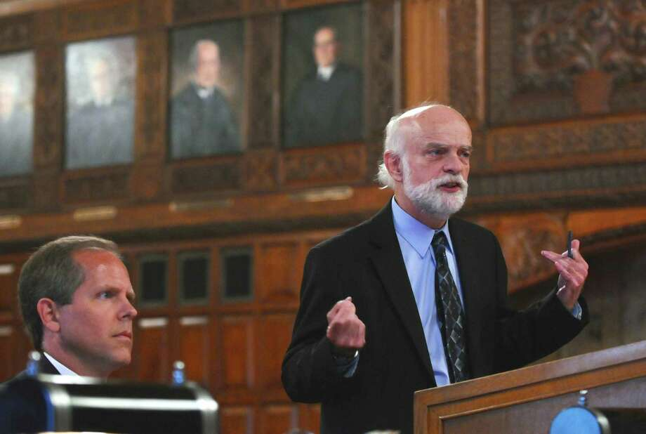 Attorney W. Andrew McCullough, representing Nite Moves, right, makes an argument as Assistant Solicitor General Robert M. Goldfarb, representing the NYS Tax Appeals Tribunal,  left, listens, in a case disputing whether Night Moves should have to pay certain state sales taxes, on  on Wednesday afternoon Sept. 5, 2012 in Albany, NY.   (Philip Kamrass / Times Union archive) Photo: Philip Kamrass / 00019131A