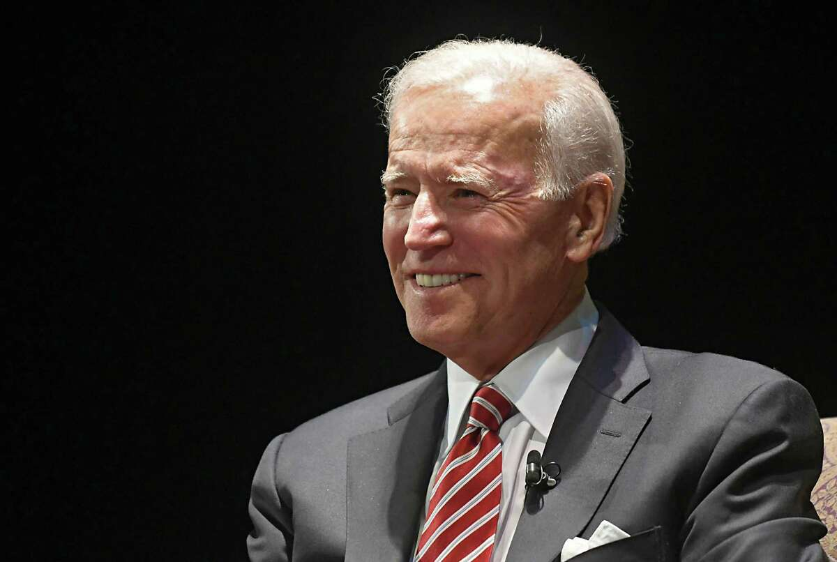 """Former Vice President Joe Biden takes the stage at Proctors during his American Promise Tour on Monday, Nov. 20, 2017 in Schenectady, N.Y. Tickets to this event included a copy of Biden's memoir, """"Promise Me, Dad: A Year of Hope, Hardship, and Purpose."""" (Lori Van Buren / Times Union)"""