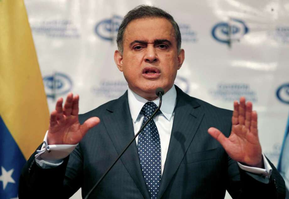 FILE - In this Aug. 23, 2017 file photo, Venezuela's Chief Prosecutor Tarek William Saab speaks during a news conference, in Caracas, Venezuela.  Venezuelan authorities detained the acting president of Citgo, the state-owned oil company's U.S. subsidiary, and five other executives for their alleged involvement in a corruption scheme, Saab said Tuesday, Nov. 21, 2017. (AP Photo/Ariana Cubillos, File) Photo: Ariana Cubillos, STF / Copyright 2017 The Associated Press. All rights reserved.