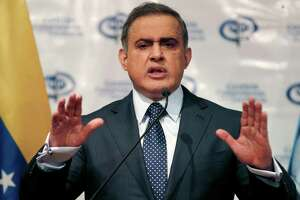 FILE - In this Aug. 23, 2017 file photo, Venezuela's Chief Prosecutor Tarek William Saab speaks during a news conference, in Caracas, Venezuela.  Venezuelan authorities detained the acting president of Citgo, the state-owned oil company's U.S. subsidiary, and five other executives for their alleged involvement in a corruption scheme, Saab said Tuesday, Nov. 21, 2017. (AP Photo/Ariana Cubillos, File)
