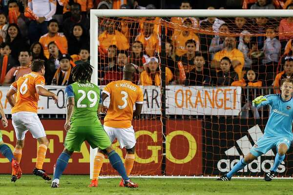 Houston Dynamo goalkeeper Joe Willis (31) dives in vain for a goal scored by Seattle Sounders defender Gustav Svensson (4) during the first half of the MLS Western Conference Finals at BBVA Compass Stadium on Tuesday, Nov. 21, 2017, in Houston.