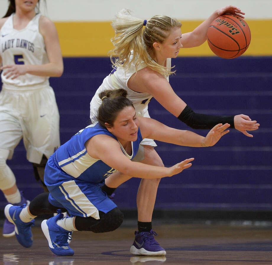 Midland High's Taysha Ruston (14) steals the ball from Lake View's Annika Velez (4) on Nov. 21, 2017, at Midland High. James Durbin/Reporter-Telegram Photo: James Durbin