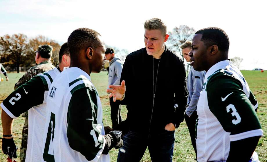 In this photo provided by the New York Jets, New York Jets quarterback Josh McCown, center, huddles up with his squad of military members at Fort Hamilton Army Base during a game of flag football in Brooklyn borough of New York, Tuesday, Nov. 21, 2017. McCown and Jets teammate Demario Davis served as coaches for the service members. McCown's team beat Davis' squad 18-14. (New York Jets.com/New York Jets via AP) ORG XMIT: NY118 Photo: New York Jets.com / New York Jets