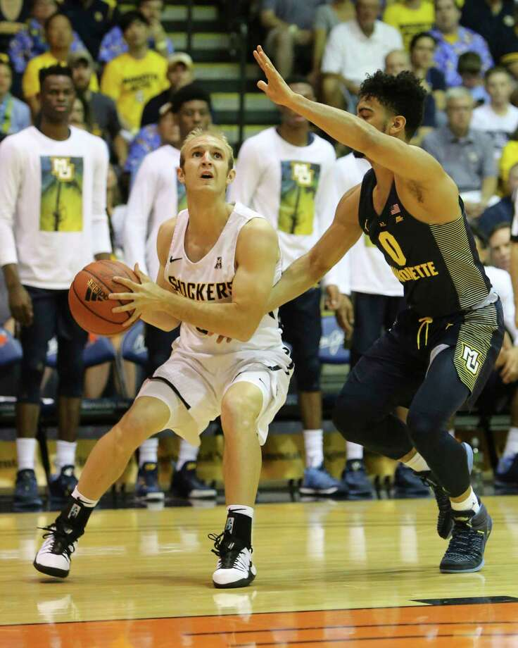 Marquette guard Markus Howard (0) guards Wichita State guard Conner Frankamp (33) during the first half of an NCAA college basketball game, Tuesday, Nov. 21, 2017, in Lahaina, Hawaii. (AP Photo/Marco Garcia) ORG XMIT: HIMG202 Photo: Marco Garcia / 2017