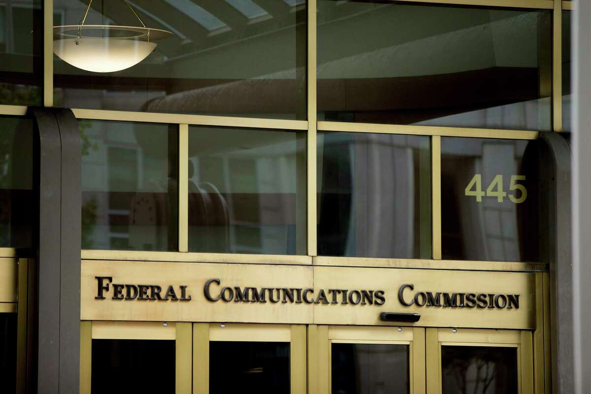 FILE - This June 19, 2015, file photo, shows the Federal Communications Commission building in Washington. Federal Communications Commission Chairman Ajit Pai is following through on his pledge to repeal 2015 regulations designed to ensure that internet service providers treat all online content and apps equally. Pai distributed his alternative plan to the net neutrality rules to other FCC commissioners Tuesday, Nov. 21, 2017, in preparation for a Dec. 14 vote on the proposal. (AP Photo/Andrew Harnik, File)