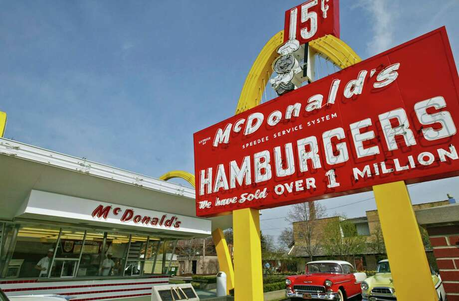 A replica of Ray Kroc's first McDonald's location stands in Des Plaines, Ill., with the original sign out front.  The Des Plaines McDonald's was the ninth McDonald's restaurant in the country, but the company considers the location to be the birthplace of the modern version of the chain, which has 36,000 locations. Photo: Ham Y. Huh, STF / Copyright 2017 The Associated Press. All rights reserved.