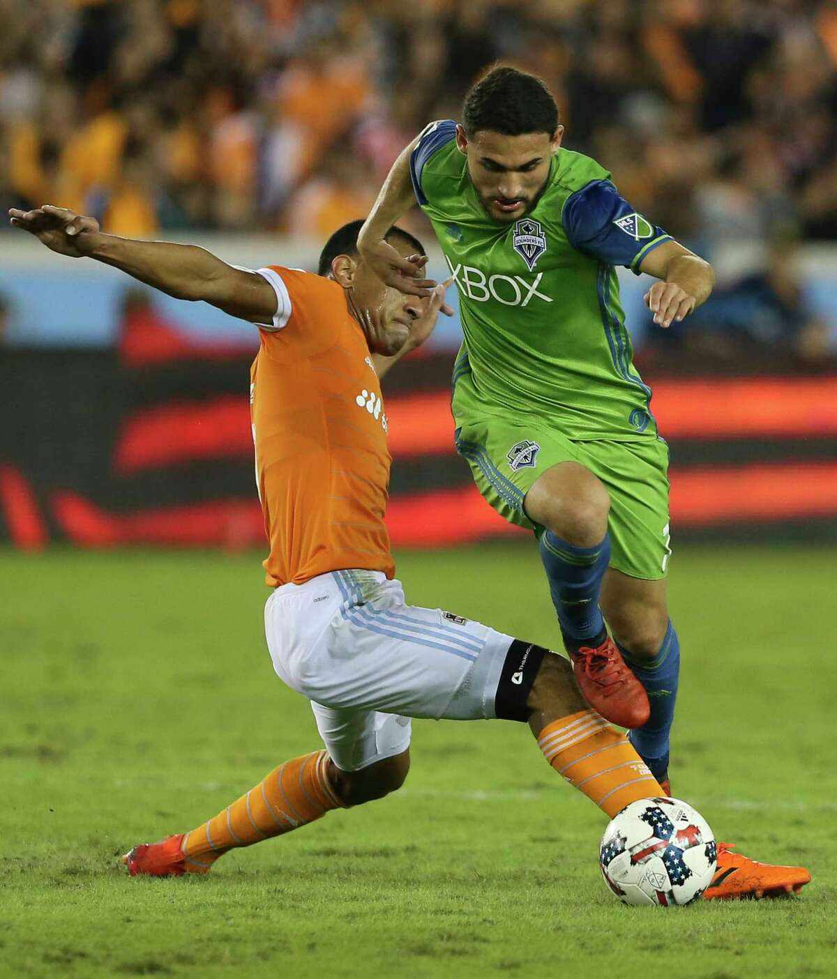 Houston Dynamo midfielder Juan Cabezas (5) tackles Seattle Sounders midfielder Cristian Roldan (7) during the second half of the first leg of the Western Conference Championship game at BBVA Compass Stadium on Tuesday, Nov. 21, 2017, in Houston. The Houston Dynamo lost to the Seattle Sounders 2-0.