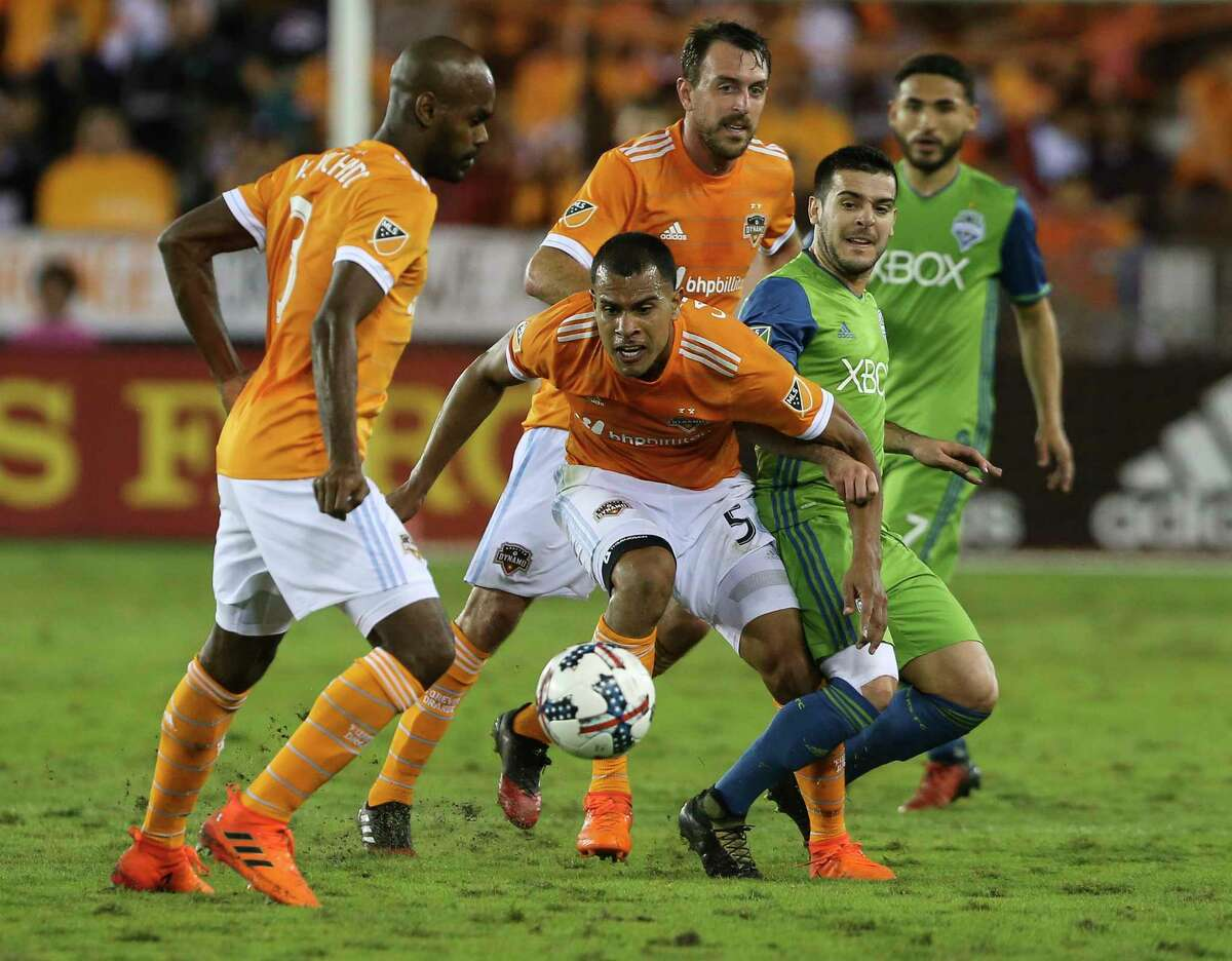 Houston Dynamo midfielder Juan Cabezas (5) makes a pass to Adolfo Machado (3) as Seattle Sounders players watch on during the second half of the first leg of the Western Conference Championship game at BBVA Compass Stadium on Tuesday, Nov. 21, 2017, in Houston. The Houston Dynamo lost to the Seattle Sounders 2-0.
