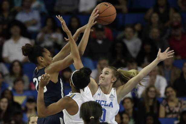 Connecticut's Azura Stevens, left, shoots over UCLA defenders in the first half at Pauley Pavilion in Los Angeles on Tuesday, Nov. 21, 2017. (Robert Gauthier/Los Angeles Times/TNS)